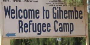 sign that points to the left and says welcome to Gihembe refuge camp