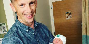 Josh holding a baby