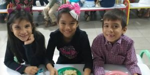 Venezuela kids with plates full of food