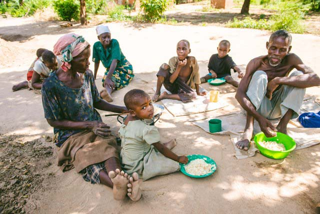 Group of Malawi villagers eating rice